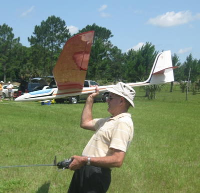 Lewis Gray is club Treasurer and has been a Buzzard since the club began. Here he prepares to launch his own design sailplane.