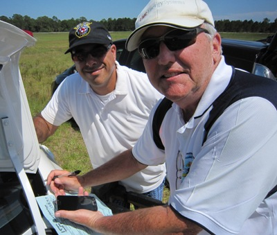Rick Eckel (Past Buzzards President) signs off on Enrico Parades LSF Sheet after a successful 1/2 hour duration flight.